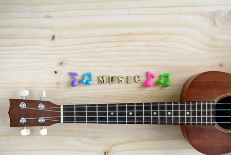 copyspace: Close up of ukulele on old wooden background with copyspace