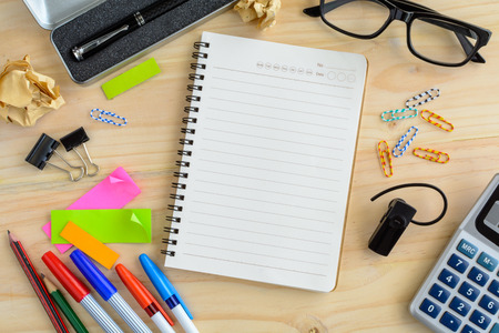 office desk: Blank notebook with office supply on desk, Workplace Stock Photo