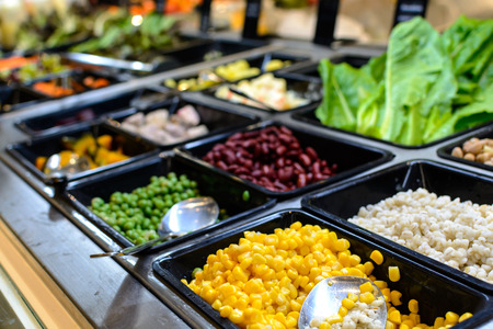 the corn salad: Close up of salad bar in supermarket
