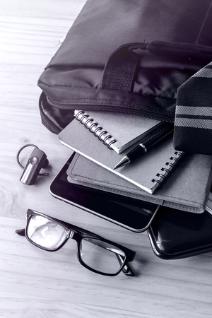 with bag: Businessman accessories and notebook bag on desk, Business concept, Monochrome tone
