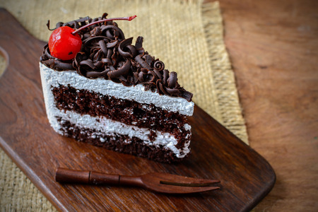 cake: Black Forest, Chocolate cake on wooden table Stock Photo