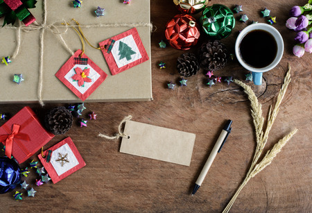 cajas navideñas: Brown gift box with cup of coffee on old wooden background, Christmas concept vintage tone