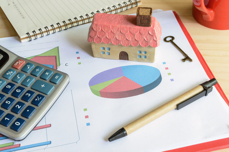 expenses: Home finance concept, residential house, expenses calculated