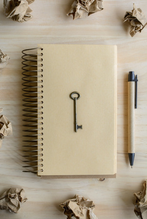 crumple: great idea concept with crumpled paper and  key on wooden table