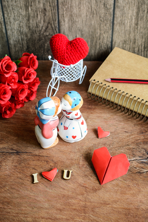 romantic heart: Lovely kissing couple on wooden background, Valentines day Stock Photo