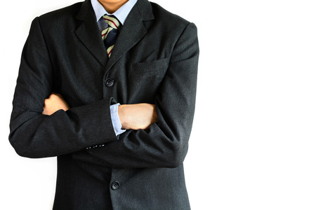 considerate: businessman standing arms crossed isolated on white background Stock Photo