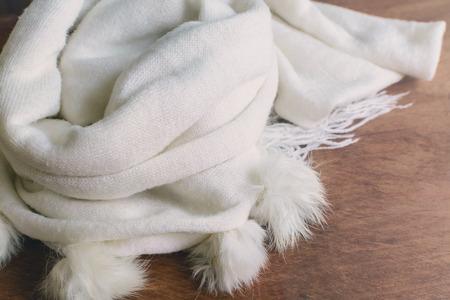 seasonal: White Scarf on wooden table, Seasonal concept
