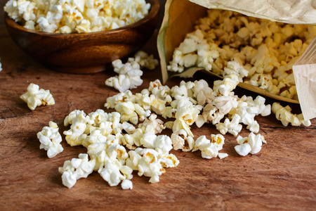 bowls of popcorn: Popcorn on wooden table
