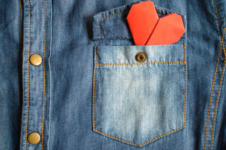 Blue jean shirt with pocket and red heart, Close up Imagens