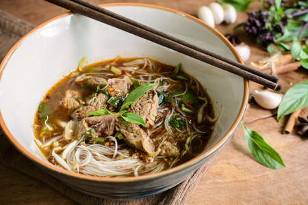 stewed: Noodle soup with Stewed pork on wooden table Stock Photo