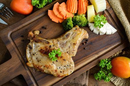 pork chop: Kurobuta pork chop steak on rustic wooden table