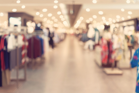 clothes shop: abstract blurred background of Department store in Shopping Mall, Vintage tone