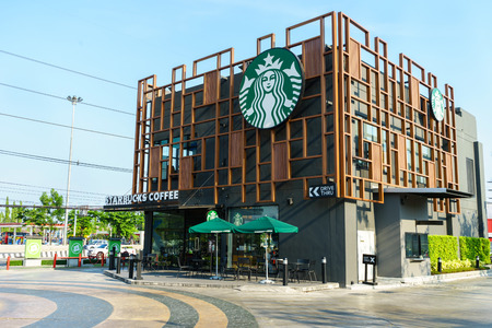 thru: BANGKOK, THAILAND - May 1, 2016: the Starbucks drive thru sign at The Paseo Park New Japanese style community mall at Kanchanapisek Road in Bangkok, Thailand