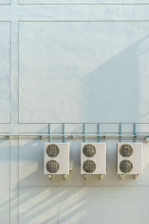 outside machines: Air conditioning compressor on the wall with copy space Stock Photo