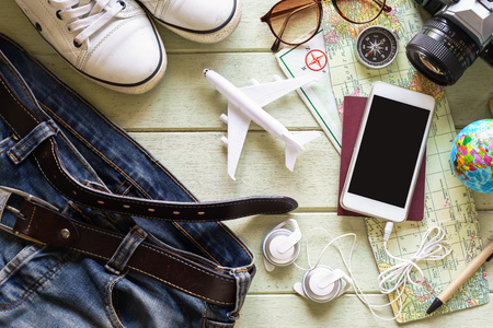 outfits: Outfits and accessories of traveler on green background with copy space, Travel concept Stock Photo