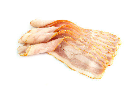 raw bacon: rolled pieces of raw bacon isolated on white background