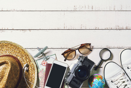 outfits: Outfits and accessories of traveler on wooden background, Travel concept