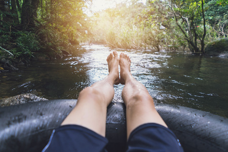 blow up: Man floating down a canal in a blow up tube