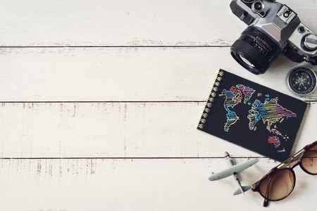 Overhead view of Traveler's accessories and items with black notebook and copy space, Travel concept 版權商用圖片
