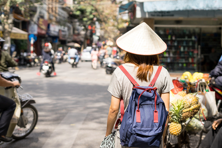 Young traveler with backpack at old quarter in Hanoi, Vietnam Stock Photo