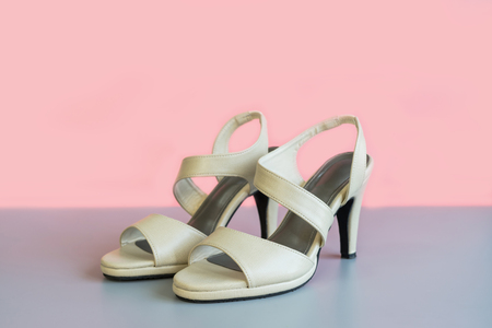Biege high heel on color background Stock Photo