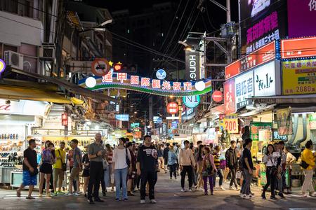 Taichung, Taiwan - November 14, 2017: People walking at Feng Chia night market, Taichung famous night market.