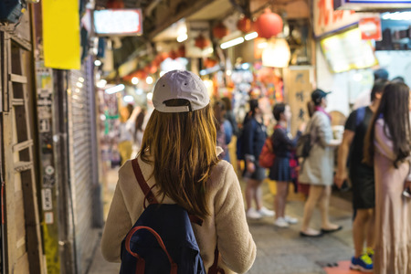 Young traveler walking at old street market at jiufen, Taiwan's most famous tourist attraction