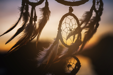Dream catcher in the wind with beautiful  sunset, Ethnic amulet Stock Photo