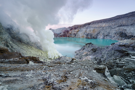 Sulfur burned by blue flame in the crater blue lake at Kawah Ijen, Indonesia Stock Photo