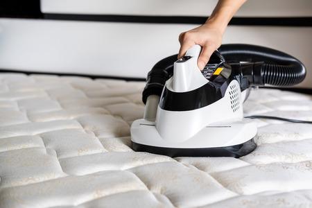 Aspirador de ácaros Eliminador de polvo de colchón de cama de limpieza Foto de archivo