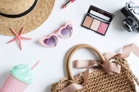 Woman and travel accessories with make up, cosmetics, brush and camera, Top view