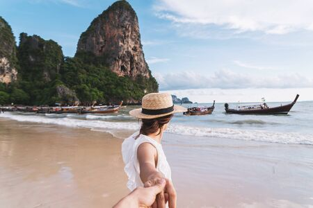 Young couple traveler enjoying a summer vacation at tropical sand beach in Krabi, Thailand 写真素材