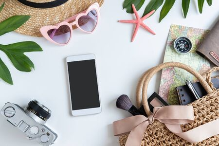 Woman and travel accessories with make up, cosmetics and empty screen smartphone, Top view