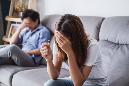 Frustrated sad wife taking off the wedding ring, Young couple breaking up divorce concept