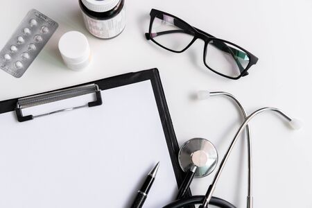 Stethoscope with clipboard and medicine, Top view, copy space, Healthcare concept