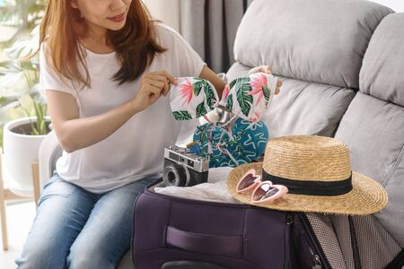 Young asian woman traveler preparing for the summer vacation, Travel concept