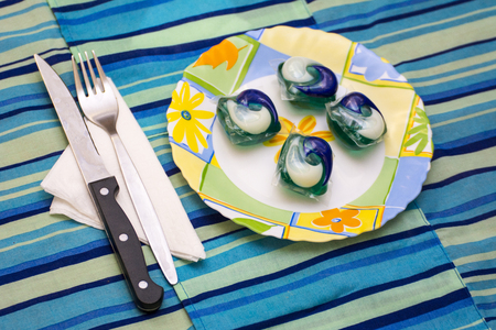 Detergent pods in a plate as concept to the tide pod challenge Reklamní fotografie