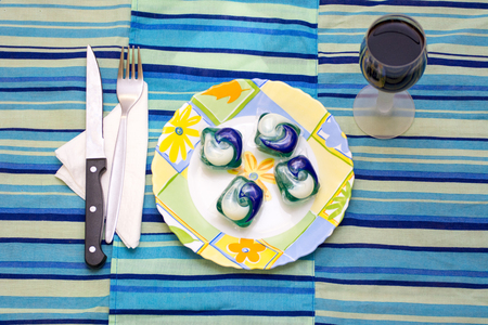 Detergent pods in a plate as concept to the tide pod challenge Archivio Fotografico