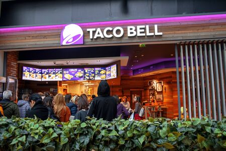 19 December 2019-Bucharest, Romania. The store front of the delicious taco bell fast food chain with mexican food