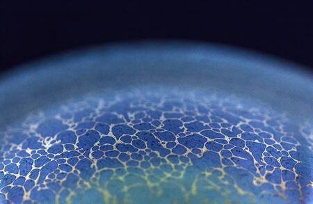 Macro on a soap bubble before it pops