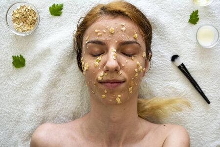 A diy face mask made out of oatmeal, honey, apple and yoghurt for skin acnee and hydration