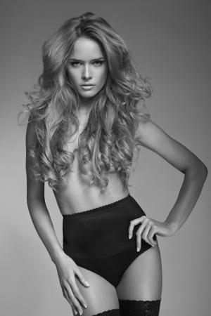 Black and white photo of beautiful sexy woman without a bra photo
