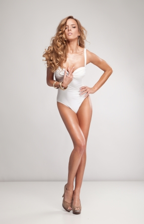 long legs: Natural attractive woman in swimsuit