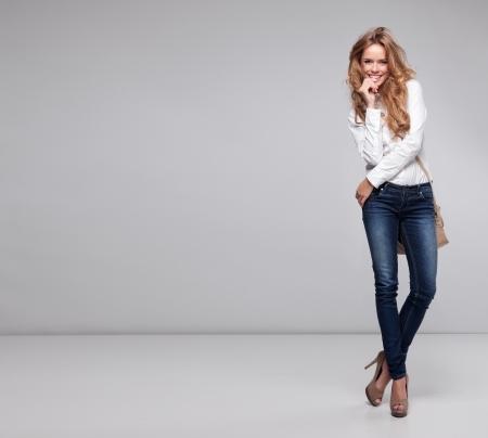 sexy woman jeans: Beautiful woman holding a handbag