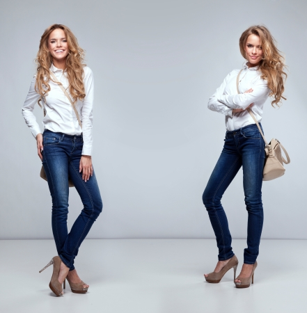 jeans girl: Beautiful twins holding a handbag
