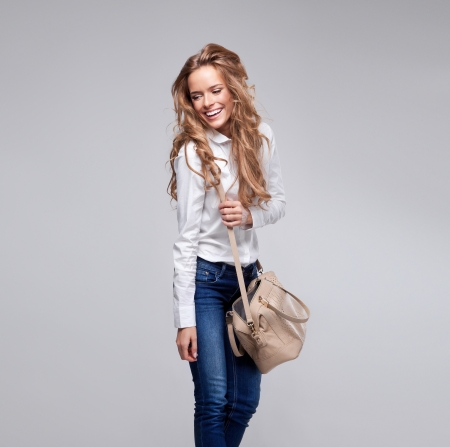 Beautiful woman holding a handbag photo