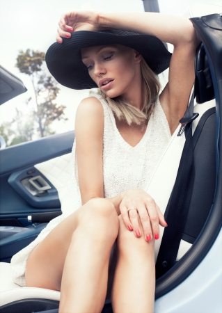 Sexy lady in the sport car photo