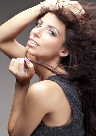 portrait of beautiful delicate brunette woman photo