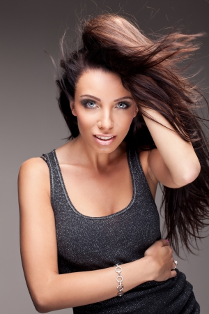 Portrait of beautiful brunette woman photo