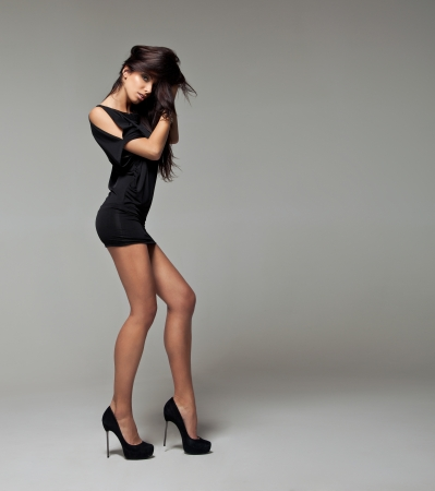 Sexy woman in black dress with long legs photo
